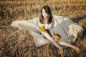 Young Beautiful Unusual Girl Illustrates Conceptual Idea In Field