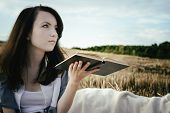 Young Unusual Girl Illustrates Conceptual Idea With Book