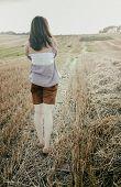 Young Beautiful Free Lonely Woman Walks Across Field