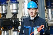 foto of plumber  - industrial construction worker plumber  at boiler room  - JPG
