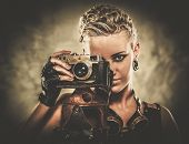 Steampunk girl with a retro camera