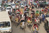 Rickshaws transport passengers in Dhaka, Bangladesh