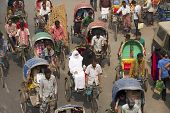 Rickshaws transport passengers in Dhaka Bangladesh.