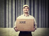 delivery man portrait and concrete background