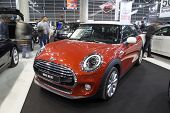 VALENCIA, SPAIN - DECEMBER 4, 2014: A red 2014 Mini Cooper at the Valencia Automovil 2014 Car Show. Mini Coopers are currently produced by BMW.