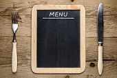 Blackboard Menu, Fork And Knife On Old Wooden Background
