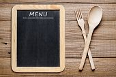 Blackboard Menu And Wooden Fork And Spoon
