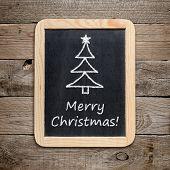 Christmas Tree And Merry Christmas! Phrase On Blackboard