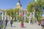 LA PAZ, BOLIVIA, MAY 8, 2014:  People walk at Plaza Murillo (Government Palace of Bolivia in background)