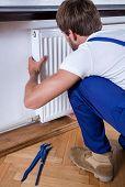 Handyman Installing A Radiator