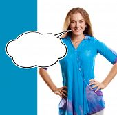 Woman in blue looking on camera with speech bubble