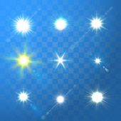 Set of Vector glowing sun light effect with sparkles on blue transparent background.