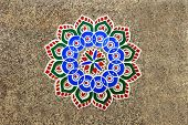 picture of rangoli  - Printed colorful geometrical pattern of rangoli stuck on mosaic tiled floor - JPG