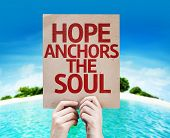stock photo of soul  - Hope Anchors the Soul card with a beach on background - JPG