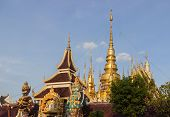 The Giant Statue In Front Of Golden Thailand Pagoda