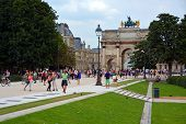 Tourists Flock To The Louvre On A Hot Summer Evening In Paris France.