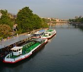 Tourist Boats Waiting For Sightseeing Passengers On The Seine River, Paris France.