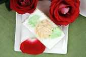 sweet food: tender cream cake served with rose