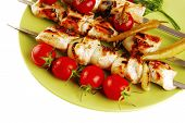 fresh roast shish kebab on green platter