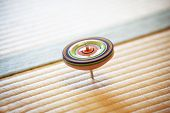 spinning top on tatami