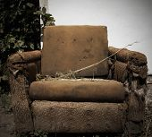 Old, torn armchair