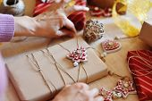 Woman Hands Wrapping Christmas Gift Pack