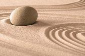 zen meditation stone in Japanese sand garden.