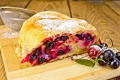 Strudel berry with strainer on board