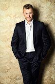 Portrait of a handsome mature man in elegant suit. Fashion, beauty.