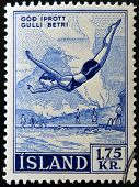 ICELAND - CIRCA 2007: A stamp printed in Iceland dedicated to swimming shows woman jumping