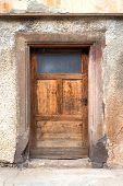 Old brown wooden door with glass insert