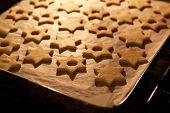 stock photo of linzer  - Christmas star Linzer cookies in the oven