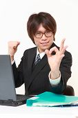 Japanese businessman showing perfect sign