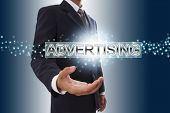 Businessman hand showing advertising word