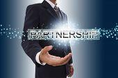 Businessman showing partnership word