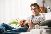 Young Guitarist At Home