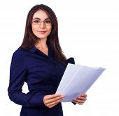 Business Woman Holding Reports And Looking At Camera, Isolated Over White
