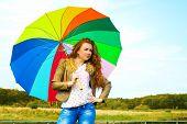 Portrait Of A Pretty Woman With Colorful Umbrella