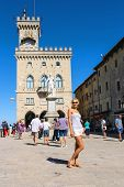 Tourists Near The Palazzo Pubblicco In San Marino. The Republic Of San Marino