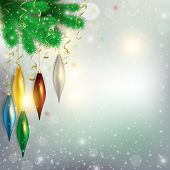 twigs of the tree with hanging colorful toys and aircraft flying