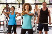 Group Exercising In A Gym