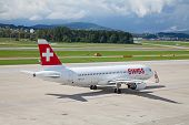 ZURICH - SEPTEMBER 21: Swiss Air A-320 preparing for flight on September 21, 2014 in Zurich, Switzerland. Zurich airport is home port for Swiss Air and one of the biggest european hubs.