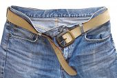 Blue denim jean and leather belt on white background