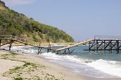 Broken Bridge On Beach