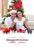 Happy couple celebrating Christmas at home against border
