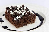 Piece Of Brownies Cake On White Background.
