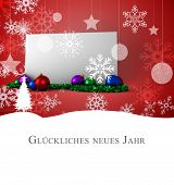 Christmas greeting in german against poster with baubles