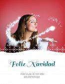 sexy santa girl blowing a kiss against feliz navidad