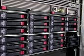 stock photo of raid  - servers stack with hard drives in a datacenter for backup and data storage - JPG