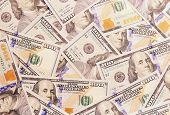 One Hundred American Dollars Banknotes Background.